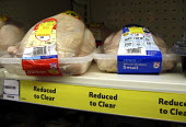 Tesco chicken reduced in price on the supermarket shelf due to food safety concerns about avian flu. London. - Jess Hurd - 30-10-2005