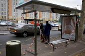 Damaged bus stop in Aulnay Sous Bois after nights of rioting. Paris, France. - Jess Hurd - 11-11-2005