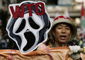 Demonstrators outside the WTO Ministerial Meeting in Hong Kong. - Jess Hurd - 2000s,2005,activist,activists,against,anti,Anti Capitalist,Asia,asian,asians,CAMPAIGN,campaigner,campaigners,CAMPAIGNING,CAMPAIGNS,capitalism,capitalist,China,Chinese,DEMONSTRATING,demonstration,DEMON