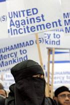 Rally against incitement & Islamophobia theTrafalgar Square rally was called in the wake of the cartoon controversy. London. - Jess Hurd - ,2000s,2006,activist,activists,against,Association,ASSOCIATIONS,bigotry,BME black minority ethnic,Bri,burka,burkas,burqa,burqas,CAMPAIGN,campaigner,campaigners,CAMPAIGNING,CAMPAIGNS,cartoon,CARTOONS,D