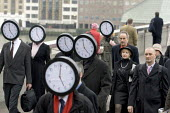 Work Your Proper Hours Day organised by the TUC. People with clock faces mingle with commuters on London Bridge. - Jess Hurd - 23-02-2006