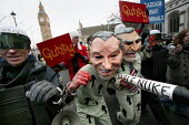 Performance artists stage the mock arrest of Tony Blair and George Bush for war crimes. Stop the War Coalition demonstration, Parliament Square, Westminster. - Jess Hurd - 2000s,2006,ACE arts culture,activist,activists,anti war,Antiwar,arrest,ARRESTED,ARRESTING,CAMPAIGN,campaigner,campaigners,CAMPAIGNING,CAMPAIGNS,Coalition,DEMONSTRATING,demonstration,DEMONSTRATIONS,ira