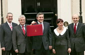 Chancellor Gordon Brown MP and his Treasury team as they leave number 11 Downing Street to deliver the Budget speech to Parliament. London. - Jess Hurd - 2000s,2006,deliver,leave,POL Politics,speech,Street,team,UK