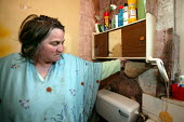 Marilyn Boyle who has been waiting for council repairs for twenty years. She has heart problems, her husband has emphysema and they live in a house riddled with woodworm which has rotted the flooring... - Jess Hurd - 20-04-2006