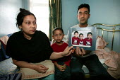 Shamsul Alam Harun, Nadira Begum Runi and their son Thasin (2),. The family of 5 are living in one room due to the appalling damp conditions in their flat which has resulted in sever eczema for their... - Jess Hurd - 20-04-2006
