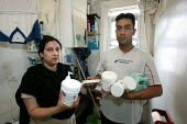 Shamsul Alam Harun and Nadira Begum Runi with the medicine of their eldest son.The family of 5 are living in one room due to the appalling damp conditions in their flat which has resulted in sever ecz... - Jess Hurd - 20-04-2006