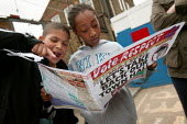 Children read Respect election materials outside Bonner Primary School, Mile End and Globe Town ward in Tower Hamlets. East London. - Jess Hurd - 2000s,2006,campaign,campaigning,CAMPAIGNS,CHILD,CHILDHOOD,Children,juvenile,juveniles,kid,kids,MATERIAL,materials,outside,people,POL Politics,School,SCHOOLS,UK,young,YOUNGER,YOUNGSTER,YOUNGSTERS