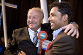 Newly elected Respect Party councillor for Mile End East - Ahmed Hussain with George Galloway MP. Tower Hamlets local election count. The Respect party won 11 seats in total. East London. - Jess Hurd - 05-05-2006