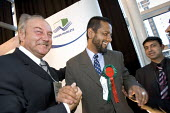 George galloway MP with Respect elected councillor Fozol Miah for Spitalfields and Banglatown. Tower Hamlets local election count. The Respect party won 12 seats in total. East London. - Jess Hurd - 05-05-2006