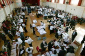 Council workers sort ballot forms at the Newham local election count. East London. - Jess Hurd - 05-05-2006