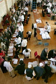 Council workers sort ballot forms at the Newham English local election count. East London. - Jess Hurd - 05-05-2006