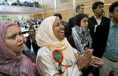 Lutfa Begum (centre) and daughter Rania Khan, elected Respect candidates. Tower Hamlets local election count. The Respect party won 11 seats in total. East London. - Jess Hurd - 05-05-2006