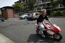 Riding a mini motorbike without a helmet. Bermondsey London. - Jess Hurd - 11-06-2006