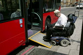 Wheelchair user accessing a London bus. - Jess Hurd - 2000s,2006,access,accessibility,adult,adults,age,ageing population,boarding,bound,bus,bus service,Bus Stop,buses,cities,city,disabilities,disability,disable,disabled,disablement,elderly,getting,incapa