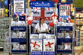 Evening Standard newspaper stand adorned with St Georges flags in support of the England World Cup football team. London. - Jess Hurd - 09-06-2006