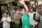 Football fans watching England lose to Portugal in the World Cup quarterfinal in an East End pub, London - Jess Hurd - 01-07-2006