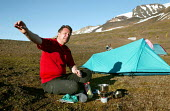 Local campaigner Halldor Gaustafsson joins a Friends of Iceland, Saving Iceland protest camp at Snaefell Mountain. The camp is highlighting the environmental concerns about a dam project at Karahnjuka... - Jess Hurd - 23-07-2006
