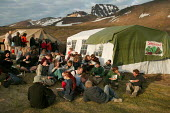 Eating dinner at the Friends of Iceland, Saving Iceland protest camp at Snaefell Mountain. The camp is highlighting the environmental concerns about a dam project at Karahnjukar. Icelands hydroelectri... - Jess Hurd - 24-07-2006