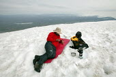 Climber uses his GPS on top of Snaefell Mountain. Iceland. - Jess Hurd - 23-07-2006