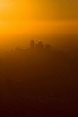 Sunrise over a misty and polluted Canary Wharf and the London Docklands. Views over London from a hot air balloon. - Jess Hurd - 08-08-2006
