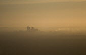 A polluted, misty sunrise over Canary Wharf, London Docklands from a hot air balloon. - Jess Hurd - 08-08-2006