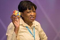 Thabitha Khumalo, 3rd Vice President, Zimbabwe Congress of Trade Unions, addresses the TUC Congress 2006, Brighton. - Jess Hurd - 2000s,2006,female,member,member members,members,people,person,persons,President,trade union,trade union,trade unions,trades union,trades union,trades unions,TUC,TUCs,woman,women,Zimbabwe