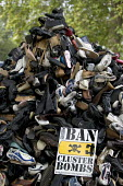 Handicap International UK urges support for victims of cluster bombs in Southern Lebanon and across the world by supporting the campaign to Ban Cluster Bombs. A pyramid of shoes represent the many kil... - Jess Hurd - 2000s,2006,activist,activists,bomb,bombs,CAMPAIGN,campaigner,campaigners,CAMPAIGNING,CAMPAIGNS,DEMONSTRATING,demonstration,DEMONSTRATIONS,Land Mine,MINE,mines,munitions,ordinance,protest,PROTESTER,PRO