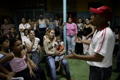 Consejo comunal, community mission organising meetings in Petare the largest Barrio in Latin America. Presidential election campaign, Caracas, Bolivarian Republic of Venezuela. - Jess Hurd - 2000s,2006,ACTIVIST,ACTIVISTS,americas,Bolivarian,CAMPAIGN,campaigner,campaigners,CAMPAIGNING,CAMPAIGNS,chavista,chavistas,communicating,communication,communities,community,conversation,conversations,