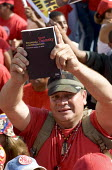 Hugo Chavez supporters with Noam Chomskys book, a critique of US policy called Hegemony or Survival Americas Quest for Global Dominance. Rally in Caracas at the close of the Presidential campaign. Car... - Jess Hurd - 2000s,2006,activist,activists,against,americas,Bolivarian,book,books,CAMPAIGN,campaigner,campaigners,CAMPAIGNING,CAMPAIGNS,chavista,chavistas,DEMONSTRATING,demonstration,DEMONSTRATIONS,Latin America,l