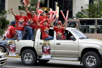 Hugo Chavez supporters ride in a calvalcade through Altamira as part of the Presidential campaign. Caracas, Bolivarian Republic of Venezuela. - Jess Hurd - 2000s,2006,activist,activists,against,americas,Bolivarian,campaign,campaigner,campaigners,campaigning,CAMPAIGNS,chavista,chavistas,DEMOCRACY,DEMONSTRATING,demonstration,DEMONSTRATIONS,election,electio