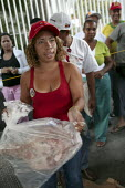 A Mission Mercal market which provides cheap, subsidised food for poor communities in Caracas. The project was introduced by the government of President Hugo Chavez. Bolivarian Republic of Venezuela. - Jess Hurd - 2000s,2006,americas,anti-poverty,Bolivar,Bolivarian,Bolivarian Mission,bought,buy,buyer,buyers,buying,commodities,commodity,consumer,consumers,customer,customers,distributing,distribution,EBF Economy,