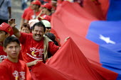 Hugo Chavez supporters including some indigenous groups from the Amazon demonstrate during the Presidential election campaign. Caracas, Bolivarian Republic of Venezuela. - Jess Hurd - 20-11-2006