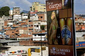 Sexist polar beer posters in Petare, the largest Barrio in Latin America. Presidential election campaign, Caracas, Bolivarian Republic of Venezuela. - Jess Hurd - 29-11-2006