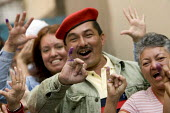 Hugo Chavez supporters celebrate at the polling station after voting in the Presidential election campaign. Caracas, Bolivarian Republic of Venezuela. - Jess Hurd - 2000s,2006,activist,activists,against,americas,Bolivarian,campaign,campaigner,campaigners,campaigning,CAMPAIGNS,CELEBRATE,celebrating,celebration,CELEBRATIONS,chavista,chavistas,DEMOCRACY,DEMONSTRATIN