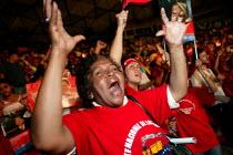 Supporters of President Hugo Chavez appaud him in a stadium where he spoke at the World Social Forum. Caracas, Bolivarian Republic of Venezuela. - Jess Hurd - 28-01-2006
