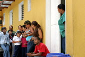 Locals queue for the doctor in a surgery which is run by Cuban doctors in an exchange deal for cheap oil for Cuba. Petare, a poor neighbourhood Barrio in East Caracas. Free drugs and treatment has bee... - Jess Hurd - 09-02-2006