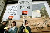 Burberry workers from the Treorchy factory in Wales bring their protest to London against factory closure and relocation to China. The Regents Street store is symbolically wrapped and sent to China. - Jess Hurd - 2000s,2007,activist,activists,against,Amicus,apparel,CAMPAIGN,campaigner,campaigners,CAMPAIGNING,CAMPAIGNS,Chinese,clothes,clothing,DEMONSTRATING,DEMONSTRATION,DEMONSTRATIONS,FACTORIES,factory,female,