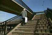 Elderly man climbs the stairs in Bexley. - Jess Hurd - 2000s,2007,a,adult,adults,age,ageing population,cities,city,elderly,footbridge,FOOTBRIDGES,Housing Estate,MATURE,OAP,OAPS,old,pensioner,pensioners,person,persons,scene,scenes,SOI social issues,stairs,