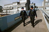 Police Community Support Officers patrol the Thamesmead housing estate, Bexley. London. - Jess Hurd - Ethnic, minority,2000s,2007,adult,adults,BAME,BAMEs,beat,black,bme,BME Black,bmes,cities,city,CLJ Crime Law and Justice,communities,community,diversity,Ethnic,ETHNICITY,female,force,housing,Housing Es