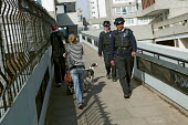 Police Community Support Officers patrol the Thamesmead housing estate, Bexley. London. - Jess Hurd - Ethnic, minority,2000s,2007,adult,adults,BAME,BAMEs,beat,black,bme,BME Black,bmes,cities,city,CLJ Crime Law and Justice,communities,community,diversity,EMOTION,EMOTIONAL,EMOTIONS,Ethnic,ETHNICITY,fema