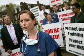 Doctorsand NHS staff rally outside Parliament to protest against reforms to their medical training which they claim will result in thousands of doctors being trained with no job to await them. Organis... - Jess Hurd - 2000s,2007,activist,activists,against,amicus,CAMPAIGN,campaigner,campaigners,CAMPAIGNING,CAMPAIGNS,claim,DEMONSTRATING,DEMONSTRATION,DEMONSTRATIONS,doctor,doctors,female,health,junior,medical,member,m