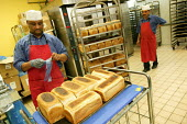 Staff producing fresh bread in the in-house bakery. Tesco Metro, Bishopsgate, London. - Jess Hurd - 2000s,2007,bake,baker,bakers,bakery,BME Black minority ethnic,bought,bread,buy,buyer,buyers,buying,cities,city,commodities,commodity,consumer,consumers,customer,customers,EARNINGS,EBF Economy,employee