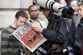 Press photographers read the paper with Blair resignation front page on the day Tony Blair resigns. Downing Street. London. - Jess Hurd - 2000s,2007,photographers,photography,POL Politics,press,resignation,ten