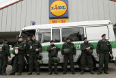 Police protect Lidl superstore from demonstrators. G8 summit in Heiligendamm, Rostock, Germany. - Jess Hurd - 2000s,2007,activist,activists,adult,adults,against,anti,anti capitalism,Anti Capitalist,CAMPAIGN,campaigner,campaigners,CAMPAIGNING,CAMPAIGNS,CAPITALISM,capitalist,CLJ,DEMONSTRATING,demonstration,DEMO