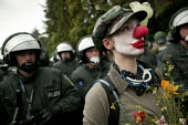 The Clown Army ridicule the police on a demonstration outside the Rostock Refugee Camp. Flight and Migration Day of Action. Protests at the G8 summit in Heiligendamm, Rostock, Germany. - Jess Hurd - 04-06-2007