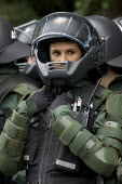 Female riot cop polices protests at the G8 summit in Heiligendamm, Rostock, Germany. - Jess Hurd - 04-06-2007
