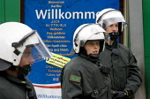 Riot police on a demonstration outside the Rostock Refugee Camp. Flight and Migration Day of Action. Protests at the G8 summit in Heiligendamm, Rostock, Germany. - Jess Hurd - 04-06-2007
