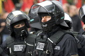Riot police with balaclavas on a demonstration outside the Rostock Refugee Camp. Flight and Migration Day of Action. Protests at the G8 summit in Heiligendamm, Rostock, Germany. - Jess Hurd - 04-06-2007
