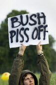 Protest at Laage Military Airport as George Bush arrives at the G8 summit in Heiligendamm, Rostock, Germany. Placard says Bush Piss Off - Jess Hurd - 05-06-2007