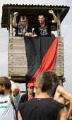 Anarchists seize a watchtower. Block G8 protests at the G8 summit in Heiligendamm, Rostock, Germany. - Jess Hurd - 06-06-2007
